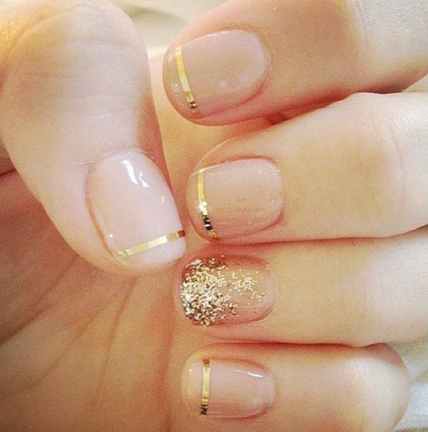 You can easily spice up a nude mani with some cute metallic stripes and sparkles.