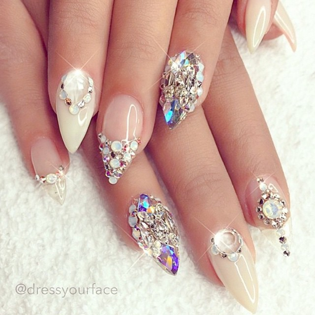 The glamorous nail art of gems upon gems definitely adds an extra oomph to this manicure!